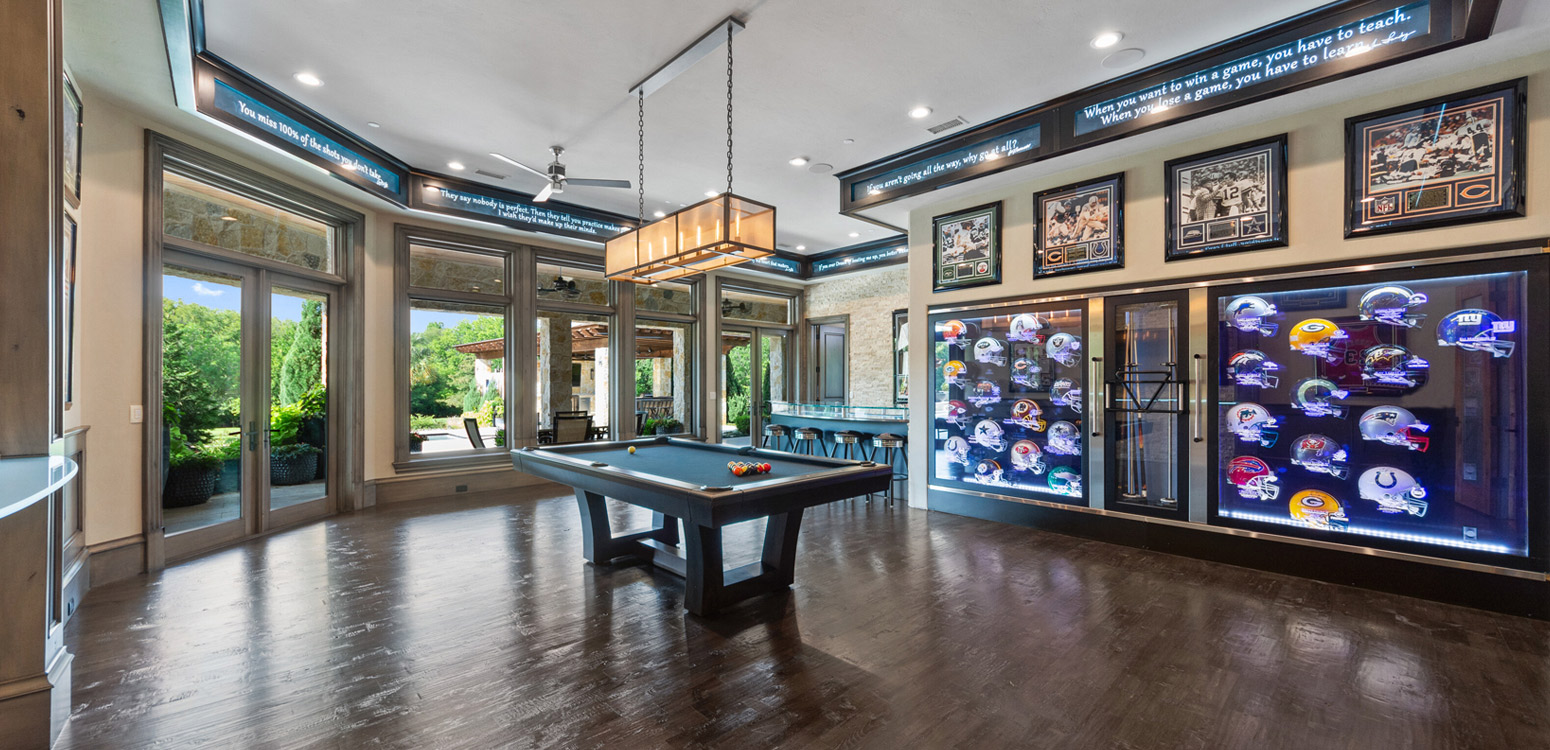 Indoor sports room with football helmet collection