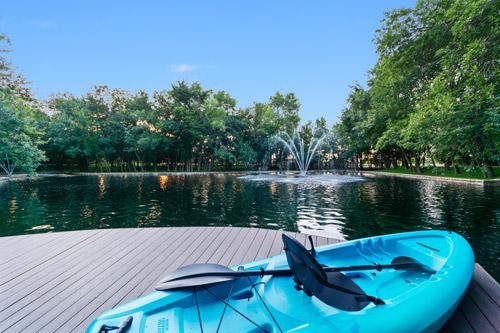 Boat near the beautiful fish pond